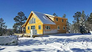 Trinity Building Systems outdoor snowy prefabricated house.