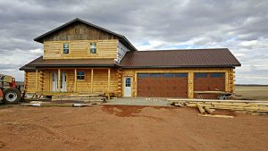 Nearly completed prefab log home by TLC log Homes and Trinity Building Systems.