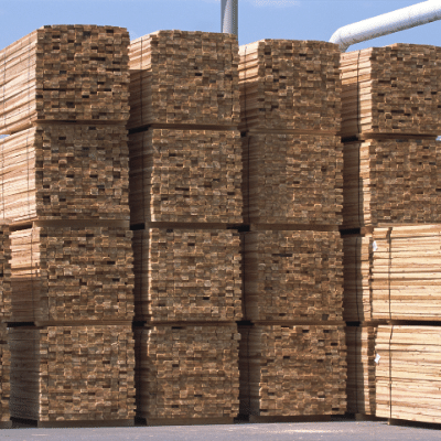 Stacks of 2x6 lumber sitting in a lumber yard ready for new construction.