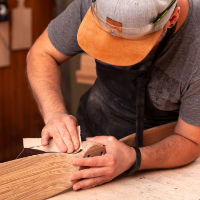 hand-crafting-wood-for-timber-frame-home