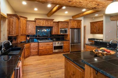 Trinity Building Systems prefabricated mountain home open kitchen design.
